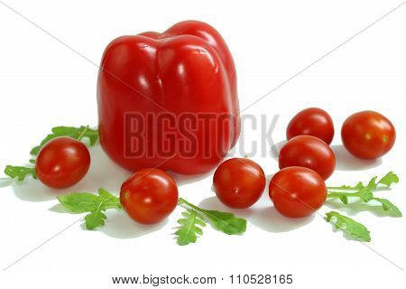paprika, tomatoes and arugula-ruccola on a white background