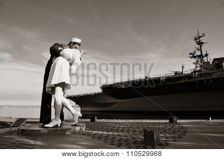 San Diego, CA - MAY 18: Unconditional Surrender sculpture at sea port on May 18, 2014 in San Diego. By Seward Johnson, the statue resembles the photograph of VJ day in Times Square