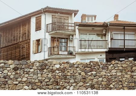 Houses Behind A Wall