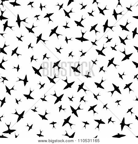 Seamless pattern with swallows silhouettes.