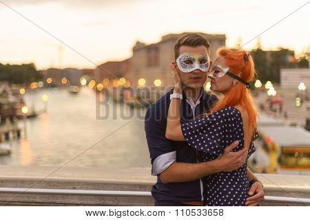 Young couple dating on the bridge in center of Venice.