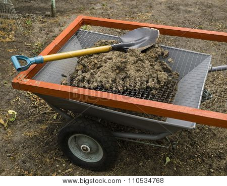 Steel Modern Cart, Sieve For Ground And Metal Shovel In The Yard