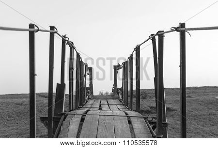 Tension Bridge Stretching Into Sunset Black And White