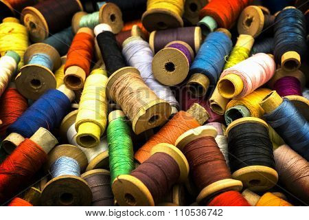 Colored High Contrasted Threads For Sewing Background With Vignetting Effect