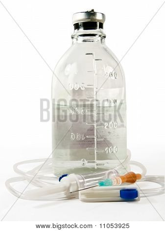 Dropper And A Bottle Of Saline Solution On A White Background