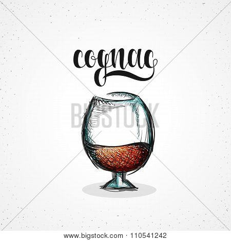 Color cognac in glass with calligraphy. Sketch by hand