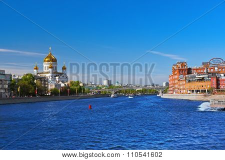 MOSCOW, RUSSIA - SEPTEMBER 05: Church of Christ the Savior and Former factory building Red October confectionery on September 05, 2014 in Moscow, Russia.
