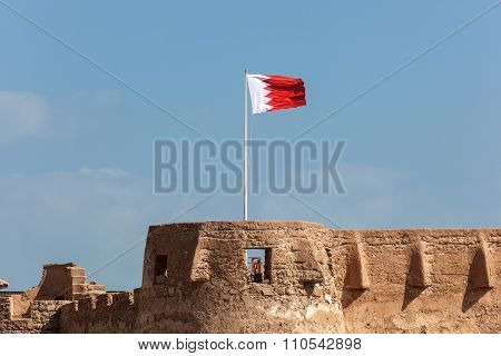 Arad Fort With The National Flag Of Bahrain