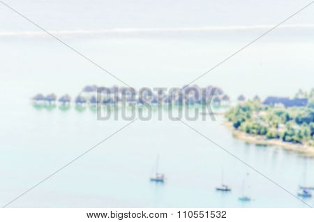 Defocused Background With Overwater Bungalows In French Polynesia