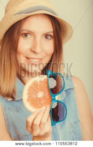 Glad Woman In Hat Holding Grapefruit
