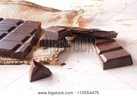 Broken Tablet Artisan Chocolate On A Wooden Table Elevated View