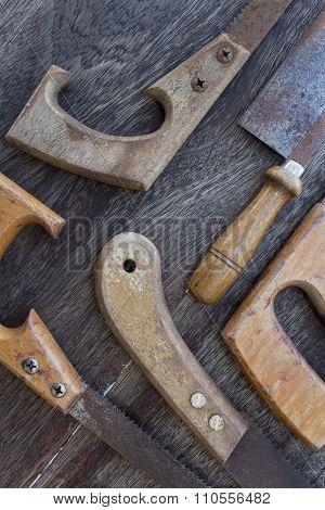 Saws / Old Handsaws Details On Wooden Background