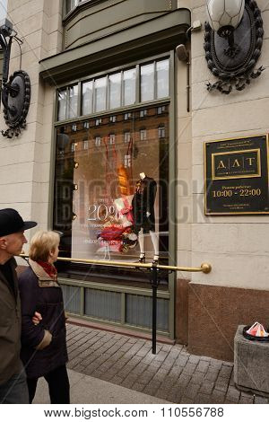 ST. PETERSBURG, RUSSIA - OCTOBER 18, 2015: People at the window of department store DLT. The windows of the oldest department store of St. Petersburg were united by the theme of Haute cuisine