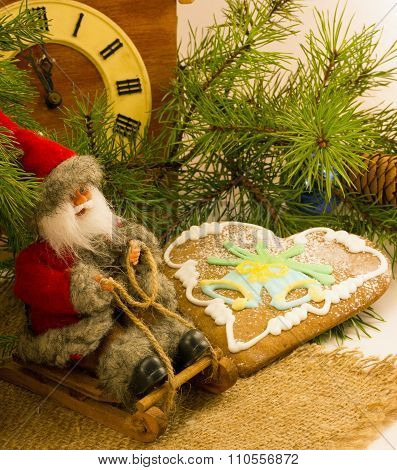 gingerbread cookies and old wooden clock , cuckoo clock and branch of Christmas tree