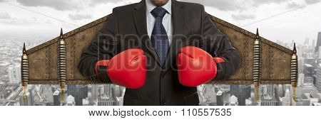 Businessman superhero in red boxing gloves. Business concept.