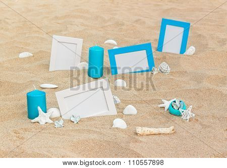 Four blank photo frames on the sand beach with decoration