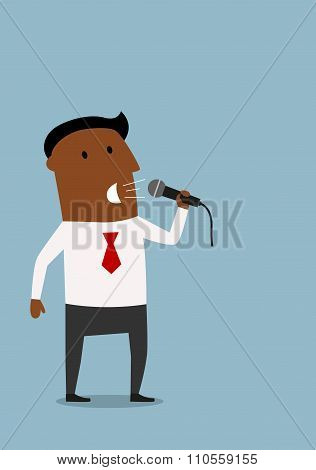 Businessman on the presentation with microphone