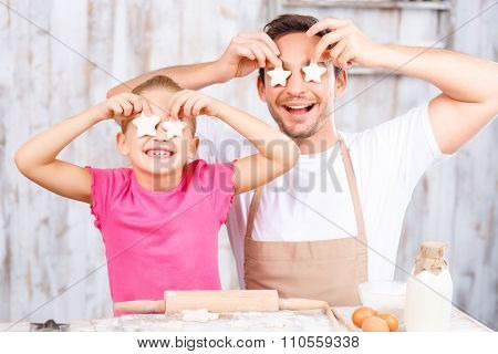 Happy daughter and father baking