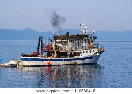 Fishing boat preparing for departure