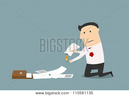 Businessman burning up a business documents