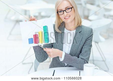 Nice businesswoman holding diagram