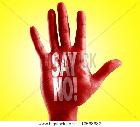 Say No! written on hand with yellow background