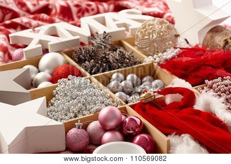 Christmas ornaments in a wooden compartment with letters xmas.