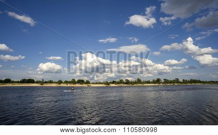 Summer Landscape With River And Clouds In The Sky.
