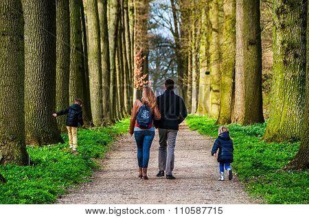 Family walking in the park in Utrecht
