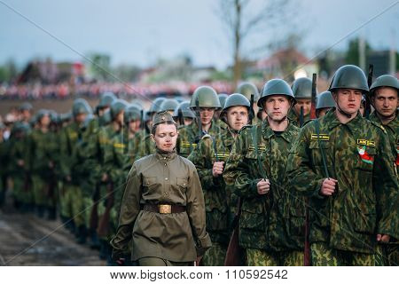 Parade of unidentified re-enactors dressed as Soviet soldiers du