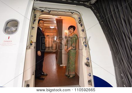 SINGAPORE - NOVEMBER 03, 2015: crew members of Singapore Airlines meet passengers. Singapore Airlines Limited is the flag carrier of Singapore which operates from its hub at Changi Airport