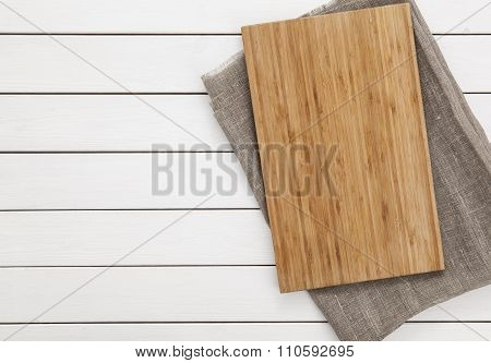 cutting board on a table. cutting board on a light wooden background. top view.
