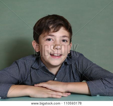 boy smiling portrait on blue wall background
