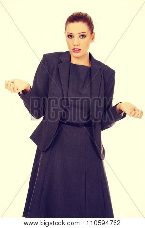 Business woman making undecided gesture.