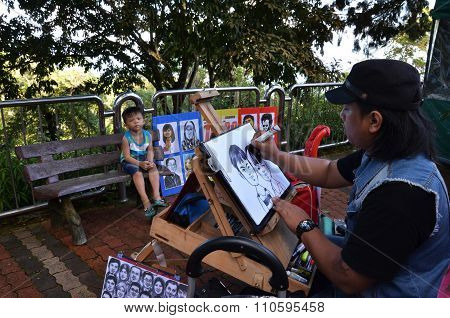 Local Artist Draws A Quick Sketch Of Children On Top Of Penang Hill