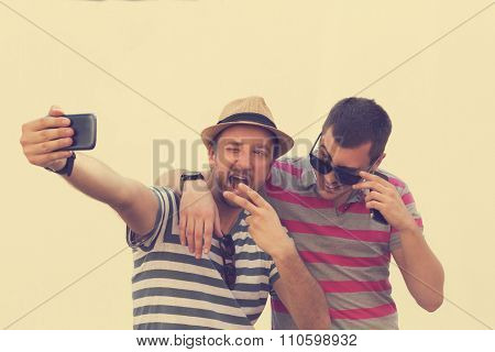 Young urban guys using a smartphone.