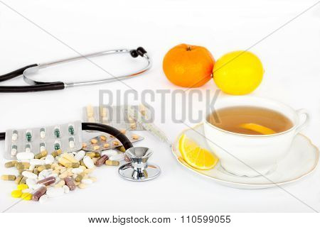 Pills and hot tea for colds and flu.