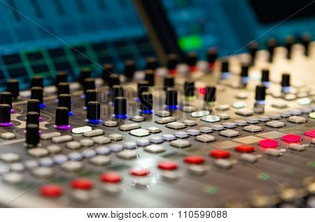 Close up footage of audio mixer