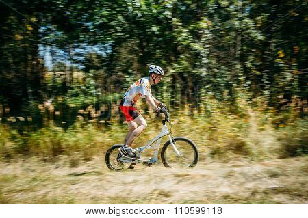 Stepper Bike cyclist riding in forest at sunny day, healthy life