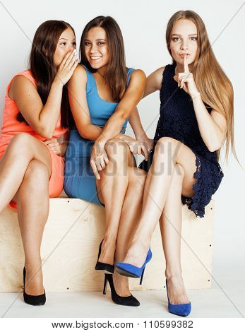 many girlfriends hugging celebration on white background, smiling talking chat, girl next door close