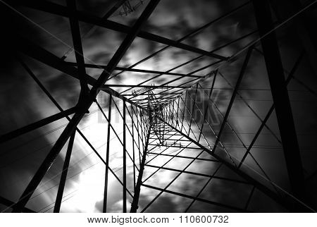 Electricity Pylon with clouds moving in Black and White
