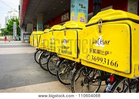 SHENZHEN, CHINA - OCTOBER 13, 2015: delivery bicycles of LaCesar pizzeria. A Shenzhen-based brand, LaCesar Pizzeria is famous for its original durian pizza