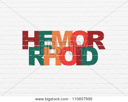 Medicine concept: Hemorrhoid on wall background
