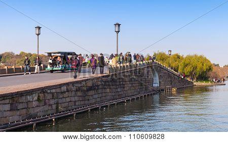 Chinese Stone Bridge On The West Lake Coast