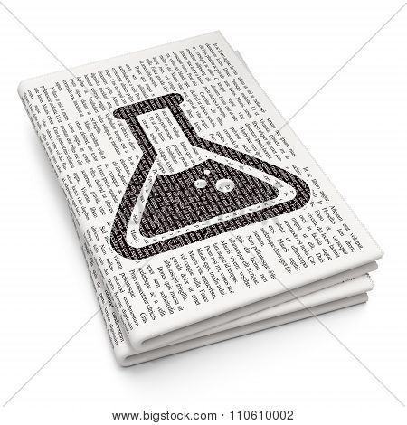 Science concept: Flask on Newspaper background