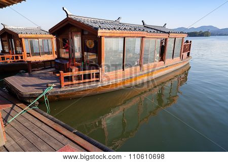 Traditional Chinese Wooden Boat With Passengers