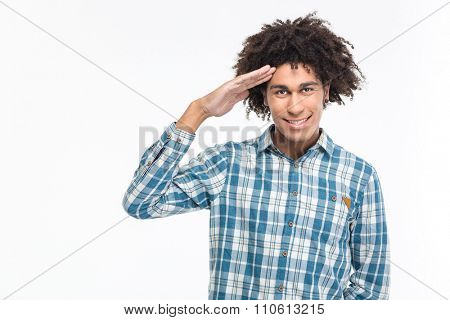 Portrait of a happy afro american man saluting isolated on a white background