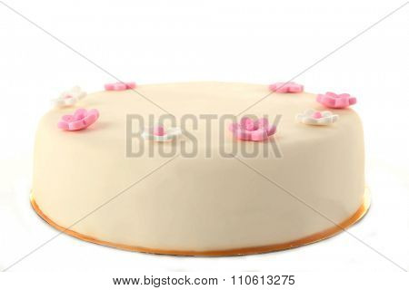 Cake with sugar paste flowers, isolated on white