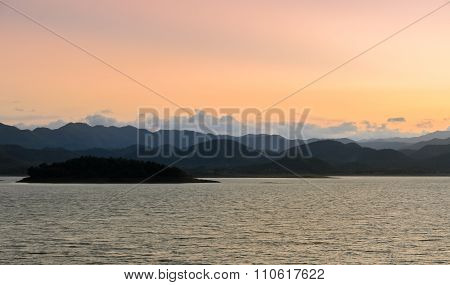 Nature Landscape Of Mountain With Lake At Sunset