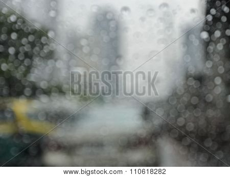 Blurry Car On Road In Rainy Day